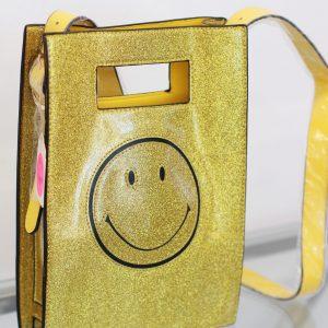 torebka złota z emotką